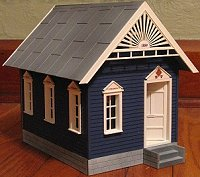 The Lewis Gingerbread House, repainted blue and white.  Click to go to article.